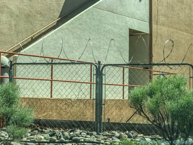 5 13 19 barbed wire fence between two hotels in NM...serious security issues! (1 of 1)